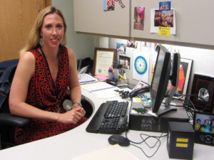 Jenny Garretson, a social worker and women veterans program manager at the Jesse Brown VA Medical Center, works in her office, where she spends some of her time making the facility more inclusive for LGBT veterans. (Photo by Sammy Caiola)