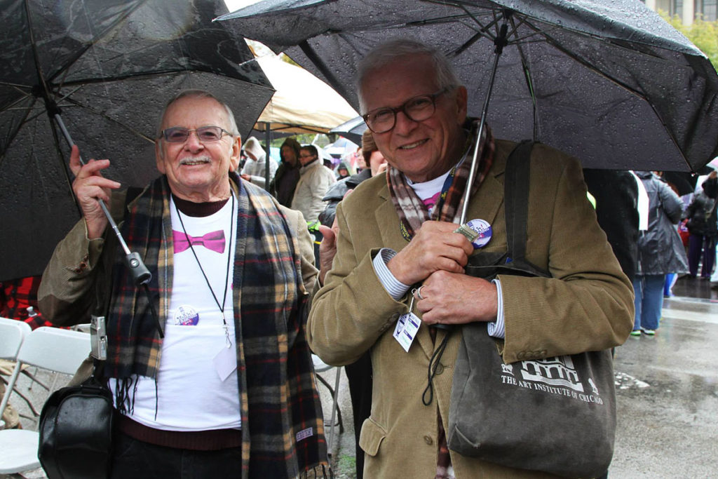 Jim Darby, left, and his husband Patrick Bova at a march for marriage equality in fall 2013 in Springfield, Ill.